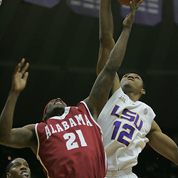 Jan 09, 2010; Baton Rouge, LA, USA; Alabama Crimson Tide guard Senario Hillman (21) has his shot blocked by LSU Tigers guard Aaron Dotson (12) from behind during the second half at the Pete Maravich Assembly Center. Alabama defeated LSU 66-49.  Mandatory Credit: Derick E. Hingle-US PRESSWIRE