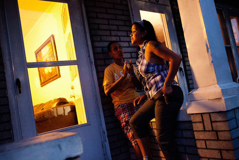 BETHLEHEM, PA – JUNE 28, 2011: Betsy and Wendy Santos of Bethlehem, Pennsylvania hang out at their stoop on June 28, 2011. As a lesbian couple, each share children from previous marriages and represent a growing number of same-sex Hispanic couples in the Lehigh Valley.<br /> <br /> As the population of second and third generation Hispanics increases dramatically in the United States, a new boldness can be sensed among Latinos in America, stretching far beyond the southern border states. Demographers in Pennsylvania say the towns of Bethlehem, Allentown and Reading are set to become majority-minority cities, where Hispanics comprise a bigger portion of the population than whites. As this minority population increases dramatically in the region, Latinos are inching closer to their own realization of the American Dream, while gradually shifting the physical and cultural landscapes of their communities.
