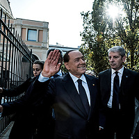 Milan, Italy -  10-10-2015: Former prime minister of Italy and President of the political party 'Forza Italia', Silvio Berlusconi, waves before arriving at a public meeting at Teatro Dal Verme.