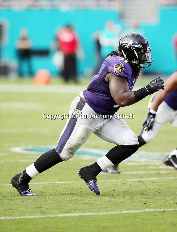 Baltimore Ravens outside linebacker Courtney Upshaw (91) chases the action during the 2015 week 13 regular season NFL football game against the Miami Dolphins on Sunday, Dec. 6, 2015 in Miami Gardens, Fla. The Dolphins won the game 15-13. (©Paul Anthony Spinelli)