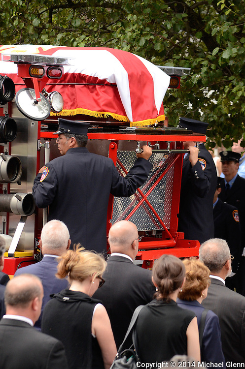Staten Island, New York - July 10: Detail prepares to remove  the casket at the Funeral of Lt Gordon M. Ambelas L119 at Saint Clares Church on July 10, 2014 in New York, New York. Photo Credit: Michael Glenn / Glenn Images