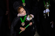 Penitents of the 'Virgen de la Esperanza' brotherhood dressed in the traditional suit La Mantilla (the mantle),  take part in a Holy Week procession in Zamora, Spain, Thursday, April 2, 2015. Hundreds of processions take place throughout Spain during the Easter Holy Week.
