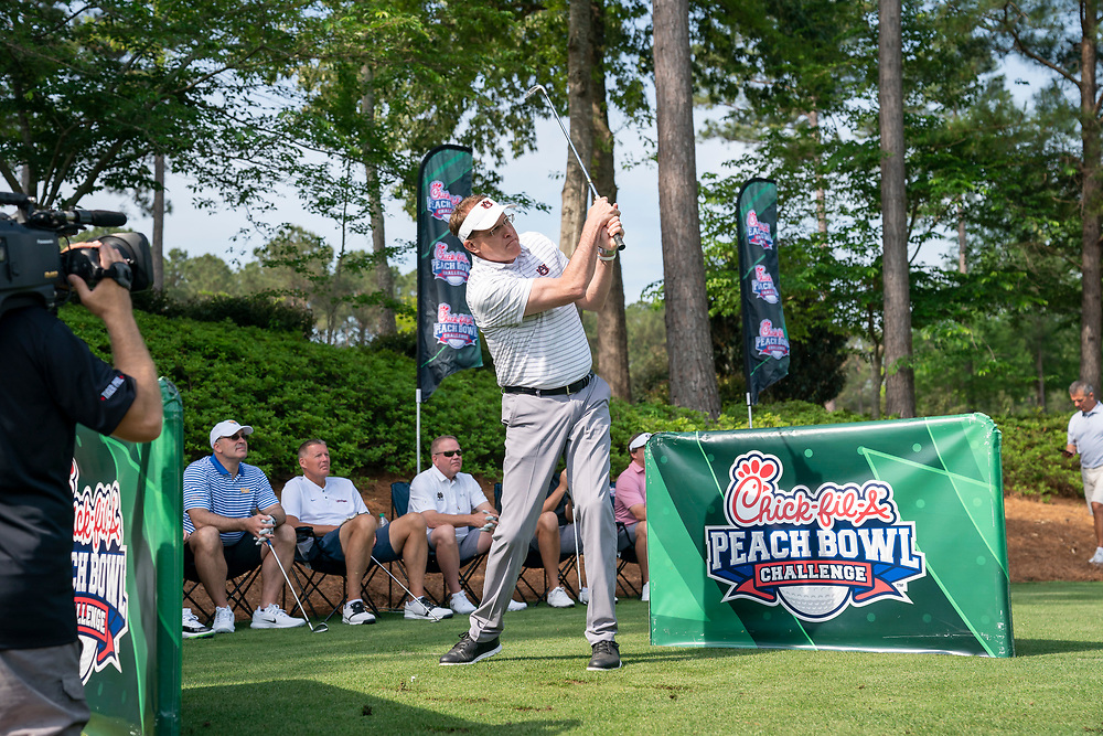Auburn head football coach Gus Malzahn tees off during the Chick-fil-A Peach Bowl Challenge Closest to the Pin Skills Competition at the Ritz Carlton Reynolds, Lake Oconee, on Monday, April 29, 2019, in Greensboro, GA. (Paul Abell via Abell Images for Chick-fil-A Peach Bowl Challenge)
