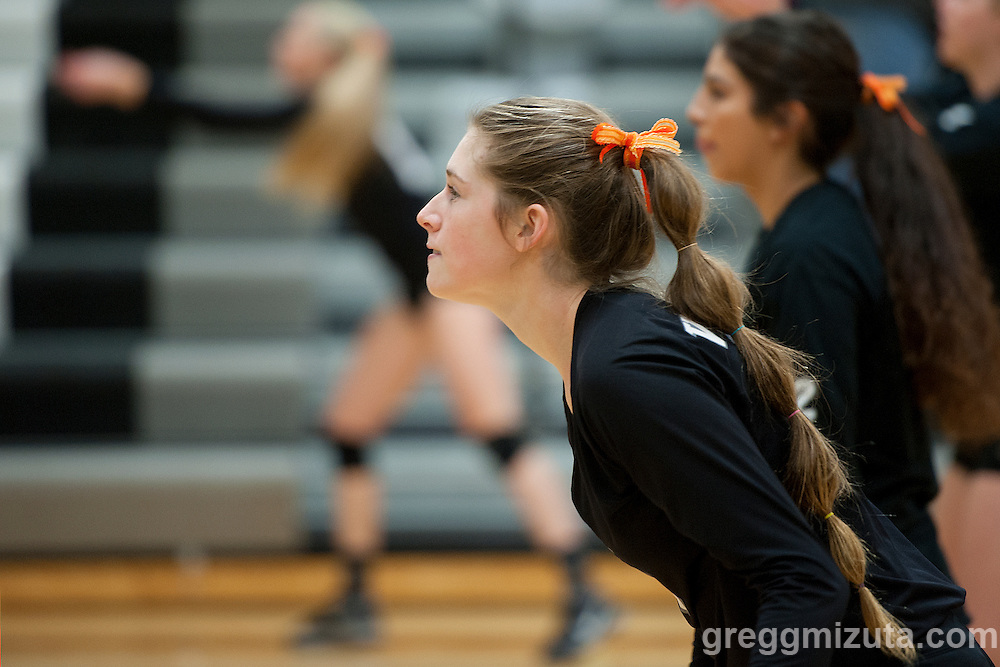 Vale senior Kelsey Weber warms up before the start of the 2015 OSAA 3A Volleyball State Championship, Round 1, Vale - St. Mary's at  Vale High School, Vale, Oregon. October 31, 2015.<br /> <br /> Vale defeated St. Mary's of Medford in three games 25-10,  25-8, 25-13, improving their season record to 24-2.