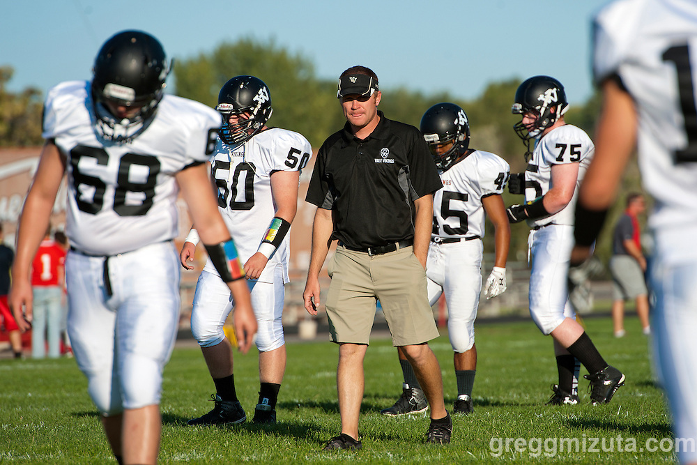 Vale coach Chance Skerjanec oversees the warm-ups before the Vale - Homedale football game, September 11, 2015 at Homedale High School, Homedale, Idaho. Homedale won 40-7.