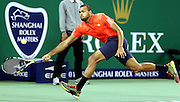 17.10.2015. Shanghai, China.  Jo-Wilfried Tsonga of France hits a return to Rafael Nadal of Spain during their semifinal match at the Shanghai Masters tennis tournament in Shanghai, east China, on Oct. 17, 2015. Jo-Wilfried Tsonga won 2-1.