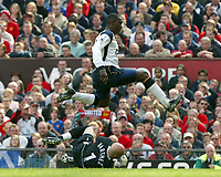 Liverpool's Emile Heskey skips over Manchester United's goalkeeper Fabien Barthez during the Premiership match at Old Trafford, Manchester, Saturday, March 5th, 2003.<br /><br />Pic by David Rawcliffe/Propaganda<br /><br />Any problems call David Rawcliffe +44(0)7973 14 2020 david@propaganda-photo.com http://www.propaganda-photo.com