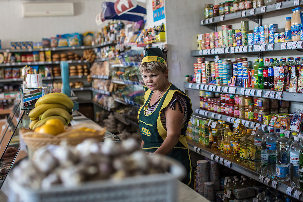 SARTANA, UKRAINE - AUGUST 29, 2015: Halina Ivanovna, a worker at a small shop selling basic food items in Sartana, Ukraine. The village of Sartana, on the northeastern outskirts of Mariupol, has been relatively close to the front line between Ukrainian and pro-Russian rebel forces, with many incidents of shelling damaging homes and injuring or killing civilians. CREDIT: Brendan Hoffman for The New York Times