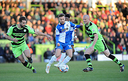 Bristol Rovers' Matty Taylor is challenged by Forest Green Rovers's Aarran Racine and Forest Green Rovers's Charlie Clough  - Photo mandatory by-line: Neil Brookman/JMP - Mobile: 07966 386802 - 29/04/2015 - SPORT - Football - Nailsworth - The New Lawn - Forest Green Rovers v Bristol Rovers - Vanarama Football Conference
