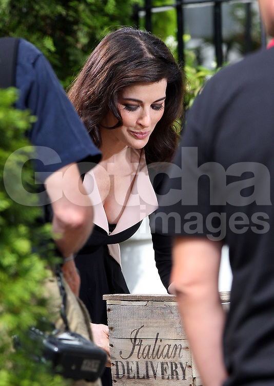 Celebrity cook Nigella Lawson filming in north London, UK. 23/08/2012<br />BYLINE MUST READ : JAMESY/GOTCHA IMAGES<br /><br />Copyright by &copy; Gotcha Images Ltd. All rights reserved.<br />Usage of this image is conditional upon the acceptance <br />of Gotcha Images Ltd, terms and conditions available at<br />www.gotchaimages.com