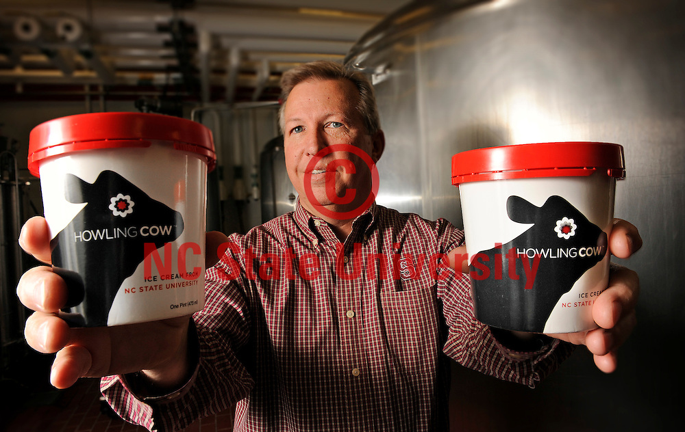 Dr. Gary Cartwright holds some Howling Cow ice cream at the Creamery in Schaub Hall. Photo by Marc Hall
