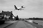 An Airbus A380 flying over the small village Oude Meer near Schiphol Airport