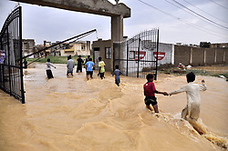 Sept. 1, 2017 - Karachi, Pakistan - Children play in flood water in southern Pakistani port city of Karachi. An emergency has been declared in Pakistan's southern port city of Karachi as heavy monsoon rains continued to lash the city. The local government has requested the Pakistani army for assistance.   (Credit Image: © Masroor/Xinhua via ZUMA Wire)