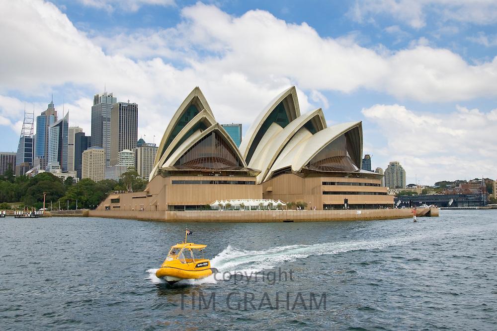 Speedboat passes Sydney Opera House in Sydney Harbour, Australia