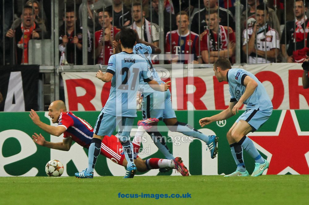 Arjen Robben (left) of Bayern Munich looks for a penalty during the UEFA Champions League match at Allianz Arena, Munich<br /> Picture by Tom Smith/Focus Images Ltd 07545141164<br /> 17/09/2014