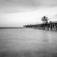 San Clemente pier black and white photo. San Clemente  is a popular beach city along the Pacific Ocean in Southern California. Photo is high resolution. Copyright ⓒ 2017 Paul Velgos with All Rights Reserved.