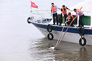 YUEYANG, CHINA - JUNE 05: (CHINA OUT) <br /> <br /> Armed police officers and harbor police of Yueyang City catch a victim\'s body at Huarong Section of Yangtze River on June 5, 2015 in Yueyang, Hunan province of China. A passenger ship named Dongfangzhixing (Eastern Star) carrying 458 people, including 406 Chinese passengers, 5 travel agency workers and 47 crew members aboard, according to the administration, sank at around 9:28 p.m. on Monday in the Jianli (Hubei Province) section of the Yangtze River. <br /> ©Exclusivepix Media