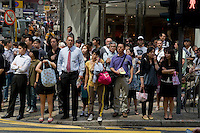 Foreigners and Chinese at lunch time in Central,Hong Kong.