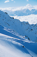 Skier on mountain slope elevated view