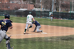 12 April 2014:  Nick Hahn hustles to first but Grant Stewart misses the put out throw during an NCAA division 3 College Conference of Illinois and Wisconsin (CCIW) baseball game between the Augustana Vikings and the Illinois Wesleyan Titans at Jack Horenberger Stadium, Bloomington IL