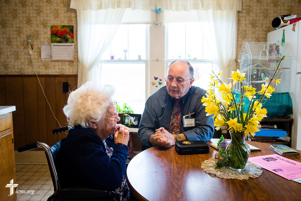 The Rev. Harold Block, visitation pastor at St. Paul's Lutheran Church, administers the sacrament to a 103 year-old church member outside Concordia, Mo., on Thursday, April 10, 2014. LCMS Communications/Erik M. Lunsford