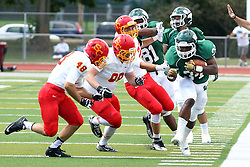 19 September 2015:  Maurice Shoemaker-Gilmore runs up the sidelines with three Storm defenders in the chase during an NCAA division 3 football game between the Simpson College Storm and the Illinois Wesleyan Titans in Tucci Stadium on Wilder Field, Bloomington IL