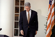 U.S President Bill Clinton walks from the Oval Office to apologize to the nation for his conduct in the Monica Lewinsky affair in the Rose Garden of the White House December 11, 1998 in Washington, DC. Clinton said he would accept a congressional censure or rebuke.