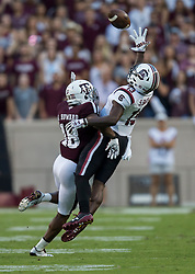 South Carolina wide receiver OrTre Smith (18) reaches for a pass as Texas A&M defensive back Antonio Howard (18) defends during the first quarter of an NCAA college football game Saturday, Sept. 30, 2017, in College Station, Texas. (AP Photo/Sam Craft)