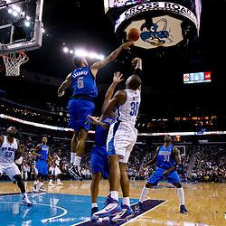 November 17, 2010; New Orleans, LA, USA; Dallas Mavericks center Tyson Chandler (6) blocks a shot by New Orleans Hornets power forward David West (30) during the second half at the New Orleans Arena. The Hornets defeated the Mavericks 99-97. Mandatory Credit: Derick E. Hingle