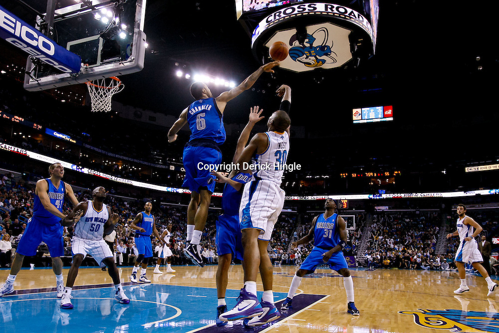 November 17, 2010; New Orleans, LA, USA; Dallas Mavericks center Tyson Chandler (6) blocks a shot by New Orleans Hornets power forward David West (30) during the second half at the New Orleans Arena. The Hornets defeated the Mavericks 99-97. Mandatory Credit: Derick E. Hingle