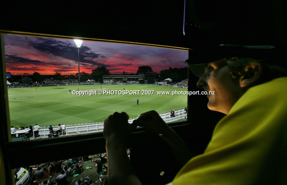A wide angle view from the manual scoreboard as the sun sets during the 3rd Chappell-Hadlee Trophy one day cricket match between New Zealand and Australia at Seddon Park, Hamilton, New Zealand on Tuesday 20 February 2007. Photo: Stephen Barker/PHOTOSPORT<br /> <br /> <br /> 200207