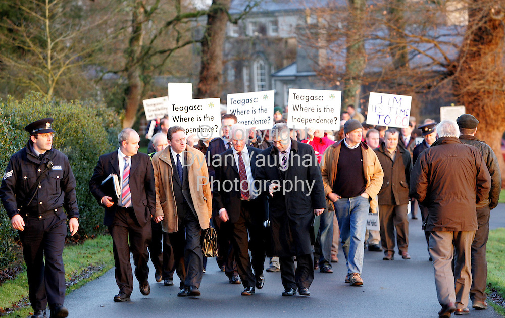 11/1/2006.Front from left Patrick Kelly, Board Member Teagasc, Jimmy Brett, Board Member Teagasc, Michael O Dwyer Board Member Teagasc  and Pat O Keeffe Chairman IFA Committee pictured walking to the Teagasc board meeting with the IFA  demonstration behind at the Teagasc Board Meeting at Mount Juliet Conrad in Thomastown in County Kilkenny yesterday.The protest is being held over the Nitrates Directive..Picture Dylan Vaughan.