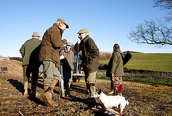UK ENGLAND GRANTHAM 15DEC11 - A gundog attends dead gamebirds during the pheasant shooting at the Belvoir Castle Estate in Leicestershire, England...jre/Photo by Jiri Rezac..© Jiri Rezac 2011