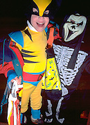Kids dressed in Halloween costumes as skeleton and Robin age 4.  St Paul  Minnesota USA