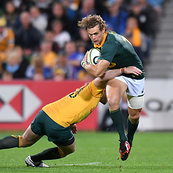 Andries Coetzee of South Africa is tackled by Bernard Foley of Australia