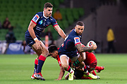 MELBOURNE, AUSTRALIA - APRIL 06: Quade Cooper of the Rebels is tackled at round 8 of The Super Rugby match between Melbourne Rebels and Sunwolves on April 06, 2019 at AAMI Park in VIC, Australia. (Photo by Speed Media/Icon Sportswire)