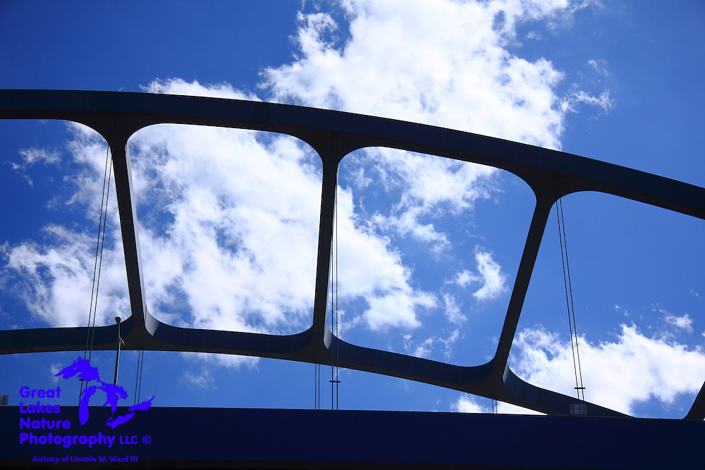 The Leo Frigo Memorial Bridge carries I-73 over the Fox River in downtown Green Bay Wisconsin. On this bright spring day in May of 2014, it also provided me with an interesting geometric element in this image that I captured from my boat on the Fox.