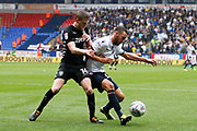 Bolton Wanderers Will Buckley (11) holds off the challenge from Leeds United Eunan O'Kane (14) during the EFL Sky Bet Championship match between Bolton Wanderers and Leeds United at the Macron Stadium, Bolton, England on 6 August 2017. Photo by Craig Galloway.