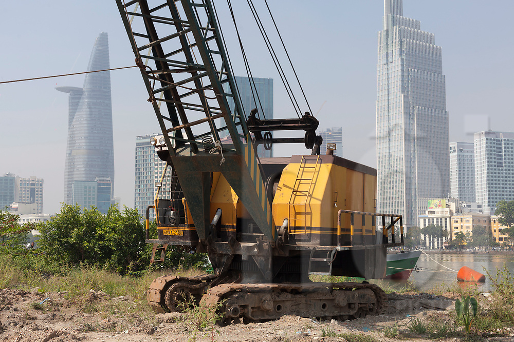 Crane parked on a wasteland along Saigon River in District 2, Ho Chi Minh City, Vietnam, Southeast Asia