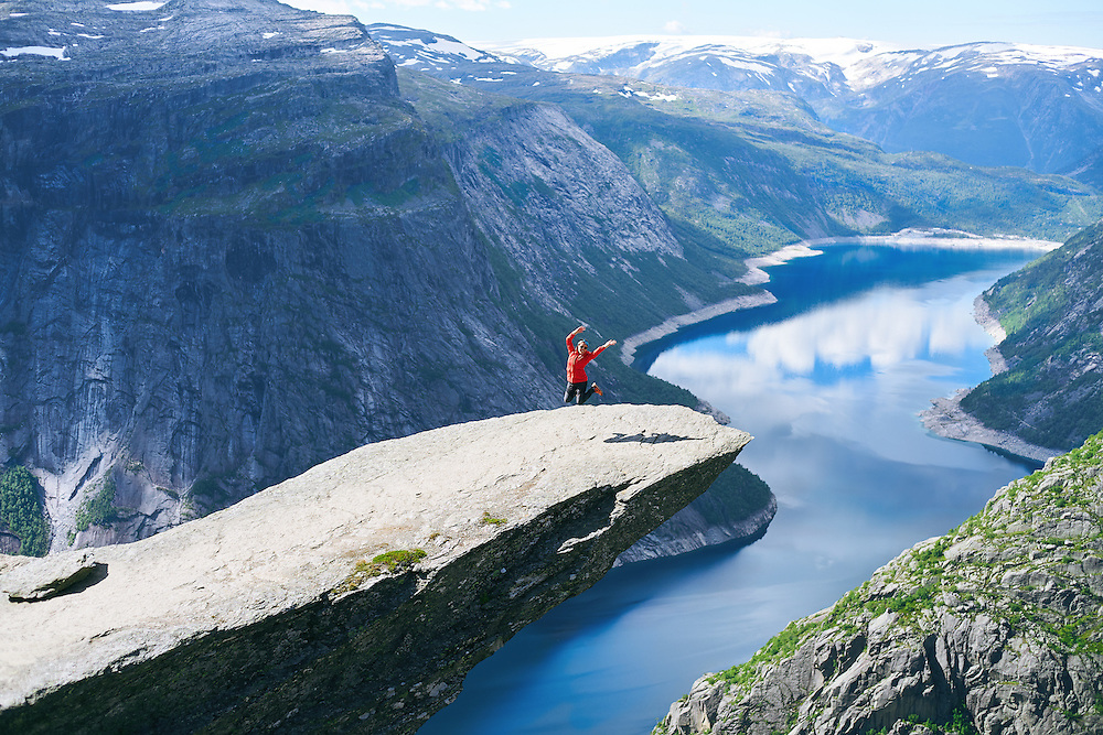 Woman jumping on Trolltunga Odda Norway