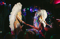 For her bachelorette party, Gezime Ameti attended the Baton Show Lounge drag queen show where Jackie Couture serenaded her. The Baton Show Lounge, now in its 48th year, is a mainstay for birthday and bachelorette parties in River North. |||| Rites of Passage define our lives. They signify the progress of time as well as our citizenship in a tribe, in a culture — in life itself. Chicago commemorates these moments in ways that reflect its diversity, but through difference, we find commonality. We are all connected through these formal and informal ceremonies that remind us how much family, love and time shape us.