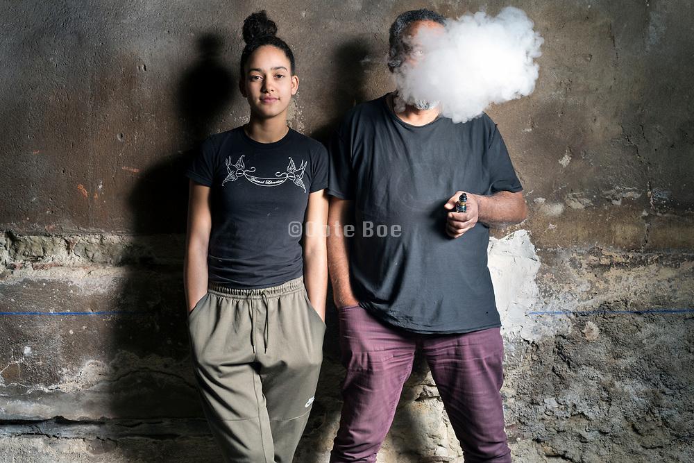 Studio portrait of photographer Pierre Alozie with his daughter. March 2019