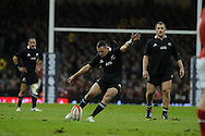 Aaron Cruden of New Zealand kicks a conversion. Dove Men autumn international series, Wales v New Zealand at the Millennium stadium in Cardiff , South Wales on Saturday 24th November 2012. pic by Andrew Orchard, Andrew Orchard sports photography,