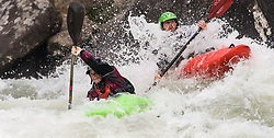 Unidentified whitewater kayakers nearly collide as power their kayaks through the rapids at Pillow Rock on the Gauley River during American Whitewater's Gauley Fest weekend. The upper Gauley, located in the Gauley River National Recreation Area is considered one of premier whitewater rivers in the country.