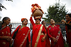 August 29, 2017 - Kathmandu, Nepal - A woman carrying the idol of Goddess Gaura on her head along with others perform a dance during Gaura Parva festival in Kathmandu. The Gaura festival is celebrated by people from far western parts of Nepal for longevity of their husbands. (Credit Image: © Skanda Gautam via ZUMA Wire)
