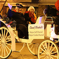 Adam Robison | BUY AT PHOTOS.DJOURNAL.COM<br /> Grand Marshals of the Tupelo Christmas Parade, Major Jeff Daniel and his wife Linda, from the Salvation Army, wave to the crowd during the Tupelo Christmas Parade Friday night in downtown Tupelo.