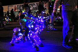 A hobby horse glows bright purple during Sunday night's 2013 Holiday Parade of Lights along Main Street in Salinas.