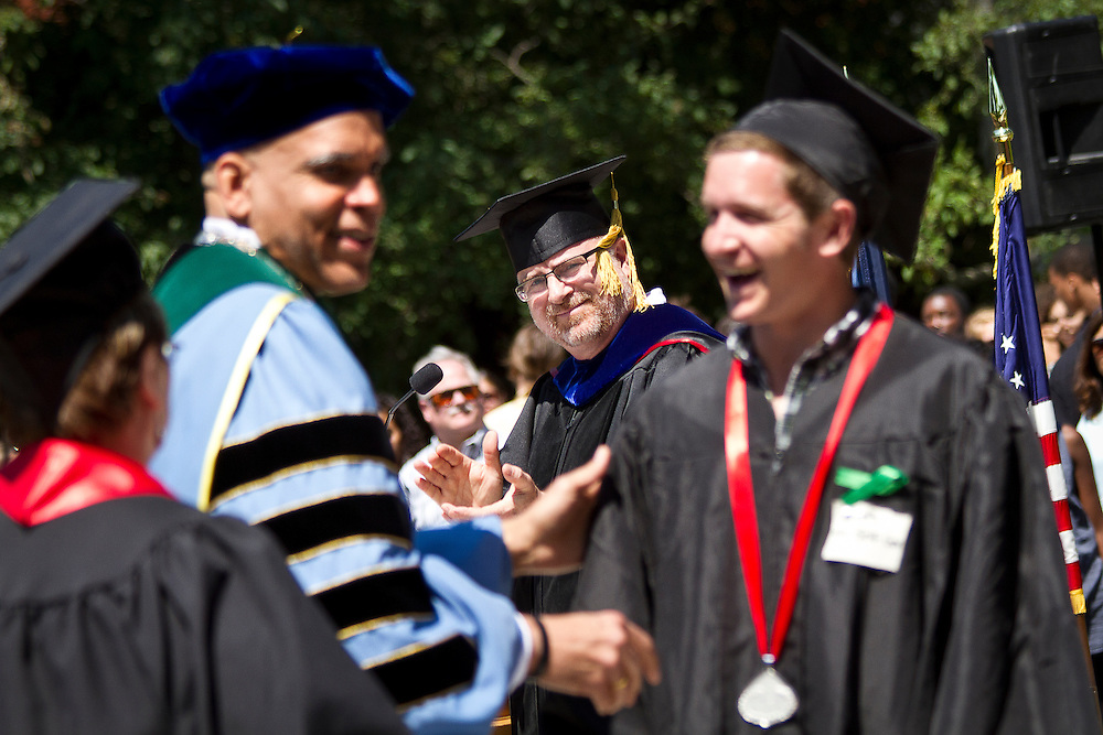 Professor of Russian Todd Armstrong applauds Eric Ritter '12, the recipient of the President's Medal, awarded annually to the student who exemplifies the ideal Grinnell student. BEN BREWER/Grinnell College