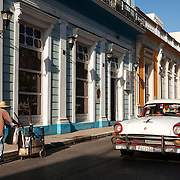 Cubans manage their daily life in the colonial city of Matanzas walking or riding bicycles to most places and doubling up on old classic cars and motorcycles. Photography by Jose More