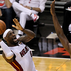 Jun 21, 2012; Miami, FL, USA; Miami Heat small forward LeBron James (6) shoots over Oklahoma City Thunder power forward Serge Ibaka (9) during the second quarter in game five in the 2012 NBA Finals at the American Airlines Arena. Mandatory Credit: Derick E. Hingle-US PRESSWIRE